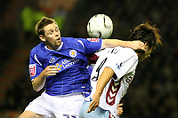Photo: Pete Lorence.<br />Leicester City v Aston Villa. Carling Cup. 24/10/2006.<br />Leicester's Andy Welsh in midair action with Juan Pablo Angel