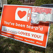 Local cafe Infusion Tea has been TPing homes in the College Park neighborhood by letting neighbors purchase a sign for the front yard and surprising other neighbors with two rolls of toilet paper on Saturday, April 4, 2020 in Orlando, Florida. Toilet paper has been scarce in the state due to panic buying due to the coronavirus (Covid-19) outbreak.(Alex Menendez via AP)