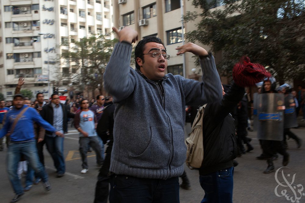 Egyptian protesters gesture for fellow protesters to break police lines and join them during continuing January 26, 2011 demonstrations in downtown Cairo, Egypt. A series of unprecedented demonstrations have broken out across Egypt for the past two days, inspired by the revolution in Tunisia, and intended to spark a similar movement in Egypt. (Photo by Scott Nelson)