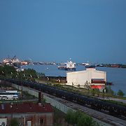 View of the Mississippi River and the new Crescent Park at sunset from the Bywater neighborhood.