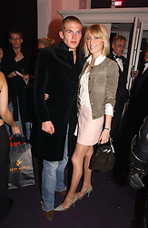 MR JACOBI ANSTRUTHER-GOUGH-CALTHORPE and LADY EMILY COMPTON at a party hosted by jeweller Theo Fennell and Dominique Heriard Dubreuil of Remy Martin fine Champagne Cognac entitles 'Hot Ice' held at 35 Belgrave Square, London, W1 on 26th October 2004.<br /><br />NON EXCLUSIVE - WORLD RIGHTS