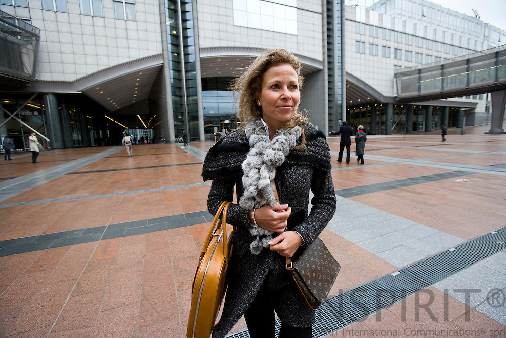 BRUSSELS - BELGIUM - 04 MARCH 2009 --  Francoise HOSSAY, Managing Director, European Fur Breeders Association (EFBA). Here walking towards Place Luxembourg with the European Parliament behind her. Photo: Erik Luntang