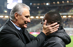 Brazil's Head Coach Tite (left) greets Cameron's head coach Clarence Seedorf