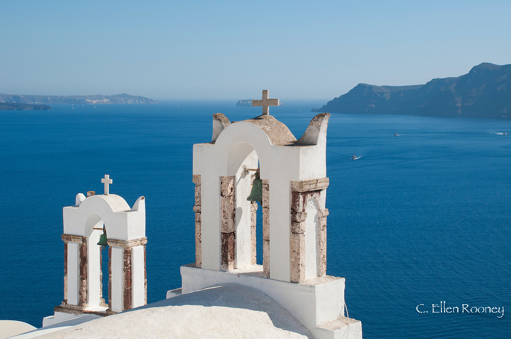 Bell towers overlooking the caldera in Oia, Santorini, The Cyclades, The Aegean, The Greek Islands, Greece, Europe