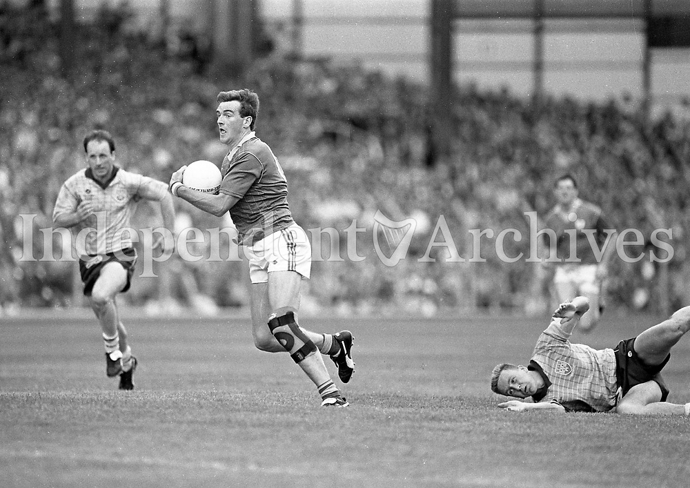 790-630<br /> Leinster Football Final at Croke Park, Dublin v Meath, 29th July 1990:<br /> Colm O'Rourke (Meath) gets the ball.<br /> Meath 1-14 Dublin 0-14<br /> Pic: Dara Mac Donaill, 29/7/90<br /> (Part of the Independent Newspapers Ireland/NLI Collection)