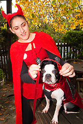 Hampstead Heath, London, October 26th 2014. Dogs rescue and re-homing charity All Dogs Matter hold their annual Halloween fancy dress dog walk on Hampstead heath. PICTURED: Marisa and her Boston Terrier Bebop.