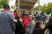 Jaye Gagnon, Brenda Boisvert and Kira Winward dancing on the Patio at the Big House during Biketemberfest on Saturday evening.  (Karen Bobotas/for the Laconia Daily Sun)
