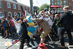 August 12, 2017 - Charlottesville, Virginia, U.S. - Neo-Nazis, white supremacists and other alt-right factions scuffled with counter-demonstrators near Emancipation Park formerly 'Lee Park' in downtown Charlottesville, Virginia. After fighting between factions escalated, Virginia State Police ordered the evacuation by all parties and cancellation of the ''Unite The Right'' rally scheduled to take place in the park. (Credit Image: © Albin Lohr-Jones/Pacific Press via ZUMA Wire)