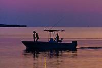 Boaters at twilight, Key Largo, Florida Keys, Florida USA