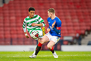 Armstrong Oko-Flex (#11) of Celtic FC has his shot blocked by Daniel Finlayson (#5) of Rangers FC during the Scottish FA Youth Cup Final match between Celtic and Rangers at Hampden Park, Glasgow, United Kingdom on 25 April 2019.
