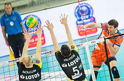 Artur Ratajczak of Lotos Trefl Gdansk and Marco Falaschi of Lotos Trefl Gdansk vs Eric Mochalski of ACH during volleyball match between ACH Volley (SLO) and Lotos Trefl Gdansk (POL) in 3rd Leg of Pool F of 2016 CEV DenizBank Volleyball Champions League, on December 3, 2015 in Arena Stozice, Ljubljana, Slovenia. Photo by Vid Ponikvar / Sportida
