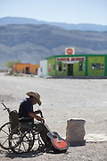 Joaquin Luna, 83, waits for tourist on the main street of Boquillas del Carmen on May 15, 2014. Two thirds of the town's residents moved away when the border was closed between 2002 and 2013 and tourist dollars dried up.