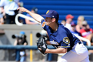 PHOENIX, AZ - MARCH 04:  Zach Davies #27 of the Milwaukee Brewers delivers a pitch against the Texas Rangers in the spring training game at Maryvale Baseball Park on March 4, 2017 in Phoenix, Arizona.  (Photo by Jennifer Stewart/Getty Images)