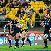 Beauden Barrett runs with the ball during the super rugby union  game between Hurricanes  and Highlanders, played at Westpac Stadium, Wellington, New Zealand on 24 March 2018.  Hurricanes won 29-12.