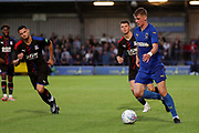 AFC Wimbledon Jack Rudoni (12) dribbling during the Pre-Season Friendly match between AFC Wimbledon and Crystal Palace at the Cherry Red Records Stadium, Kingston, England on 30 July 2019.