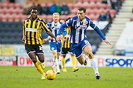 Yanic Wildschut of Wigan Athletic and Larnell Cole of Shrewsbury Town during the Sky Bet League 1 match at the DW Stadium, Wigan<br /> Picture by Matt Wilkinson/Focus Images Ltd 07814 960751<br /> 21/11/2015