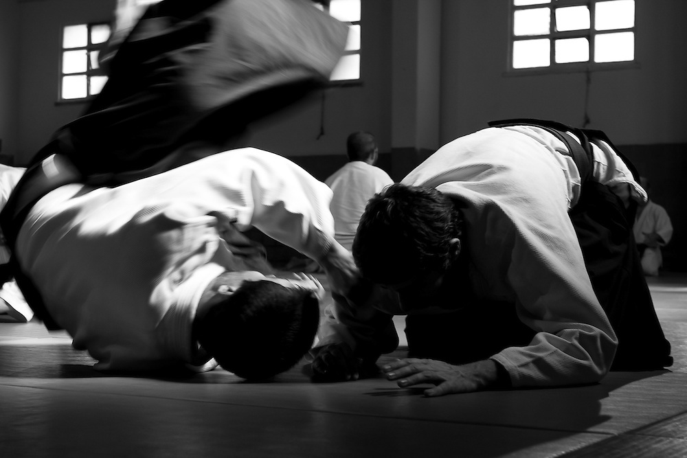 An aikido student projects another one during a seminar