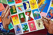 La Lotería mural, Austin, Texas, August 12, 2015. La Lotería is a mural in East Austin originally painted in the 1980s, became badly faded and was painted over by SXSW Music Festival. Anger expressed by community members led to an apology from SXSW and the mural's eventual restoration by Arte Texas, a nonprofit that focuses on art in East Austin.