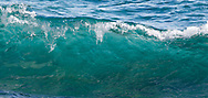 Breaking wave has a nearly transparent wall, showing the aqua color of the seawater. Kauai, © 2010 David A. Ponton