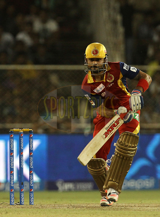 Royal Challengers Bangalore captain Virat Kohli plays a shot during match 22 of the Pepsi IPL 2015 (Indian Premier League) between The Rajasthan Royals and The Royal Challengers Bangalore held at the Sardar Patel Stadium in Ahmedabad , India on the 24th April 2015.<br /> <br /> Photo by:  Vipin Pawar / SPORTZPICS / IPL