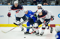 Bostjan Golicic of Slovenia vs John Moore jr. of USA, Mark Arcobello of USA and Ben Smith of USA during Ice Hockey match between Slovenia and USA at Day 10 in Group B of 2015 IIHF World Championship, on May 10, 2015 in CEZ Arena, Ostrava, Czech Republic. Photo by Vid Ponikvar / Sportida