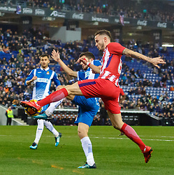 BARCELONA, Dec. 23, 2017  Atletico de Madrid's Saul Niguez (front) competes during a Spanish league match between RCD Espanyol and Atletico de Madrid in Barcelona, Spain, on Dec. 22, 2017. RCD Espanyol won 1-0. (Credit Image: © Joan Gosa/Xinhua via ZUMA Wire)