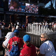 August 30, 2017 - New York, NY : People watch the second round match between Maria Sharapova and Timea Babos on screens outside Arthur Ashe Stadium, on the third day of the U.S. Open, at the USTA Billie Jean King National Tennis Center in Queens, New York, on Wednesday. <br /> CREDIT : Karsten Moran for The New York Times