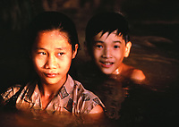 Children swimming in the Mekong, My Tho, Vietnam