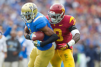 17 October 2012: Wide receiver (1) Shaquelle Evans of the UCLA Bruins catches a pass and is tackled by (18) Dion Bailey of the USC Trojans during the first half of UCLA's 38-28 victory over USC at the Rose Bowl in Pasadena, CA.