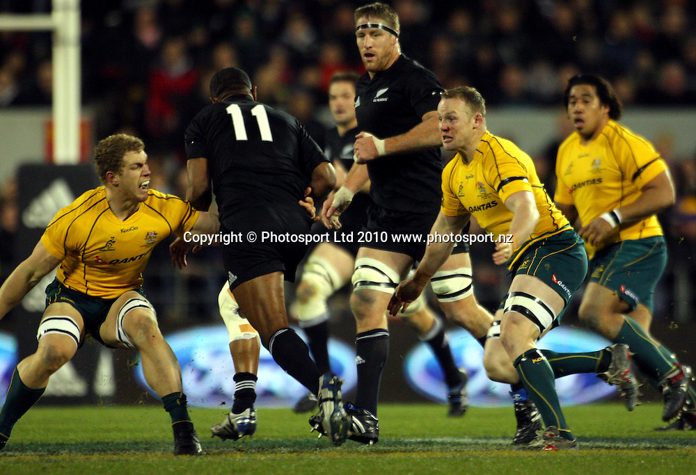 All Blacks winger Joe Rokocoko runs between David Pocock and Richard Brown. Investec Tri-Nations - Bledisloe Cup match - All Blacks v Australia at AMI Stadium, Christchurch on Saturday 6 August 2010. Photo: Dave Lintott/PHOTOSPORT