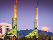 The full moon rises over Mount Tabor Park, framed by the glass towers of the Oregon Convention Center, Portland, Oregon. This full moon appearing on the 31 July 2015 is called a Blue Moon, which refers to the second of two full moons appearing in the same calendar month. The last time this happened was in 2012, and another one isn't due until 2018.