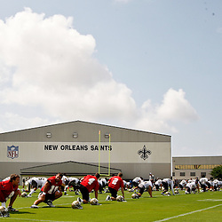 June 5, 2010; Metairie, LA, USA; New Orleans Saints quarterback Drew Brees (9) and teammates stretch during a mini camp practice at the New Orleans Saints practice facility. Mandatory Credit: Derick E. Hingle