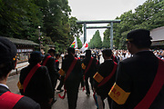 Members of a Taiwanese rightwing group, who wish to see Japanese rule returned to Taiwan, march in the rain as Yasukuni shrine marks the 72nd anniversary of the end of the Pacific War. Yasukuni Shrine, Kudanshita, Tokyo Japan. Tuesday August 15th 2017. Nominally a event to honour Japan's war dead and call for continued peace, this annual gathering  at Tokyo's controversial Yasukuni  Shine also allows many Japanese nationalists to display their nostalgia for their Imperial past.Rightwing paramilitary groups, Imperial cos-players, politicians and many ordinary citizens come together at the shrine to march and wave flags. The day goes almost unreported in the mainstream Japanese media.
