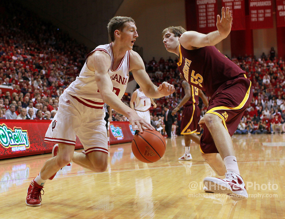 Jan. 12, 2012; Bloomington, IN, USA; Indiana Hoosiers forward Cody Zeller (40) dribbles against Minnesota Golden Gophers center Elliott Eliason (55) along the baseline at Assembly Hall. Minnesota defeated Indiana 77-74. Mandatory credit: Michael Hickey-US PRESSWIRE