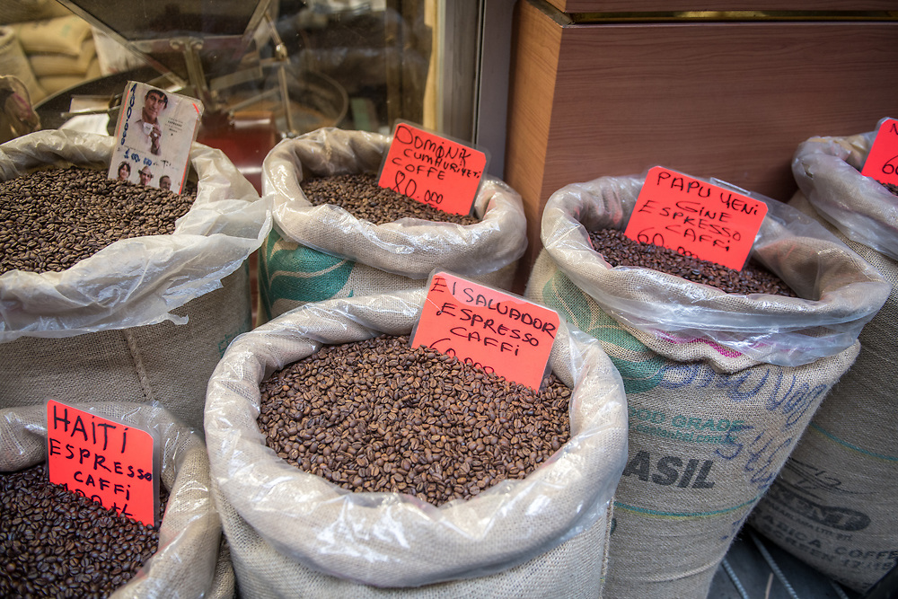 Linen bags are filled to the brim with a variety of different blends of roasted coffee beans,  Istanbul, Turkey.
