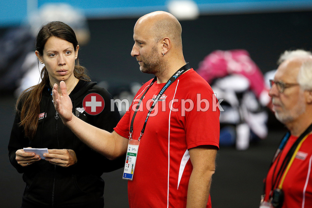 Swiss Swimming osteopath Nicola Poulsen (L) is listening to coach Dirk Reinicke during a training session 2 days prior to the start of the 12th Fina World Short Course Swimming Championships held at the Hamad Aquatic Centre in Doha, Qatar, Monday, Dec. 1, 2014. (Photo by Patrick B. Kraemer / MAGICPBK)