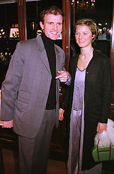 Photographer DAN STEVENS and MISS CANDIDA PERCEVAL, at a party in London on 11th February 1999.MOI 91