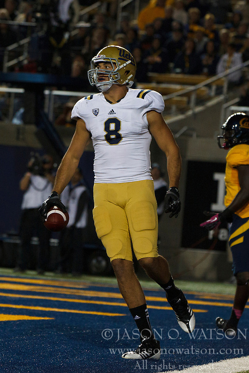 BERKELEY, CA - OCTOBER 06: Tight end Joseph Fauria #8 of the UCLA Bruins scores a touchdown against the California Golden Bears during the third quarter at California Memorial Stadium on October 6, 2012 in Berkeley, California. The California Golden Bears defeated the UCLA Bruins 43-17. (Photo by Jason O. Watson/Getty Images) *** Local Caption *** Joseph Fauria