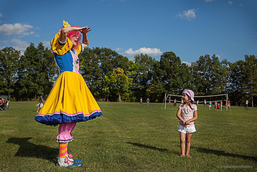 "With Gianna Maloney, 4, smiling straight ahead, Crystal the Clown pretends to be looking for children to play with and to her pretend frustration, not finding any. ""Clowning is what I'm meant to do,"" Crystal said. ""It's where I feel most comfortable."""