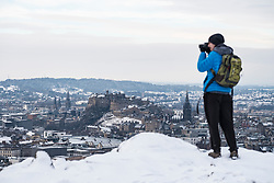 Edinburgh, Scotland, United Kingdom. 29 December, 2017; Snow falls on Edinburgh enhancing views of the city. Edinburgh Castle viewed from Salisbury Crags.