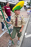 Sept. 22, 2012 - Bellmore, New York U.S. - Wearing a large Corn on the Cob hat, is cub scout from North Bellmore Cub Scout Troop 313, as troop sells popcorn to raise funds at the 26th Annual Bellmore Family Street Festival. More people than the well over 120,000 who attended last year are expected, according to the Festival Coordinator.