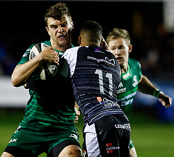 Thomas Farrell of Connacht is tackled by Keelan Giles of Ospreys<br /> <br /> Photographer Simon King/Replay Images<br /> <br /> Guinness PRO14 Round 7 - Ospreys v Connacht - Friday 26th October 2018 - The Brewery Field - Bridgend<br /> <br /> World Copyright © Replay Images . All rights reserved. info@replayimages.co.uk - http://replayimages.co.uk