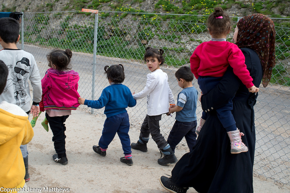 Greece with Doctors of the World (Medecins du monde). Chios Island, one of the places where refugees from Turkey land en route to Northern Europe. Souda camp. A mother and her children.
