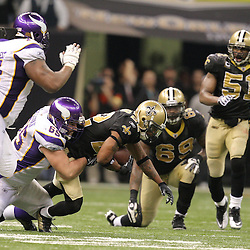 Jan 24, 2010; New Orleans, LA, USA; Minnesota Vikings center John Sullivan (65) tackles New Orleans Saints cornerback Tracy Porter (22) after returning an interception during the fourth quarter of a 31-28 overtime victory by the New Orleans Saints over the Minnesota Vikings in the 2010 NFC Championship game at the Louisiana Superdome. Mandatory Credit: Derick E. Hingle-US PRESSWIRE