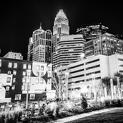 Charlotte NC downtown at night black and white photo with Romare Bearden Park. Charlotte, North Carolina is a major city in the Eastern United States of America. Includes Bank of America Corporate Center, Bank of America Plaza, and 121 West Trade buildings.