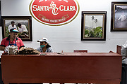 Cigar workers check finished cigars before sending them for aging at the Santa Clara cigar factory in San Andres Tuxtlas, Veracruz, Mexico. The factory follows traditional hand rolling using the same process since 1967 and is considered by aficionados as some of the finest cigars in the world.