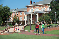 Students walk and talk in the Court of North Carolina. In the background is the 1911 building. Photo by Marc Hall