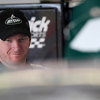 Sprint Cup Series driver Dale Earnhardt Jr. (88) in the garage area at Daytona International Speedway on February 18, 2011 in Daytona Beach, Florida. (AP Photo/Alex Menendez)