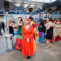 LONDON, ENGLAND - JANUARY 20:  Dancers try to keep warm before The Big Dance 2010 Launch  at the Old Spitafields Market on January 20, 2010 in London, England. 10,000 people expected to take part in The Big Dance which will take place between July 3-11.  (Photo by Marco Secchi/Getty Images)