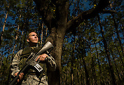 Airman First Class Robert Badger takes a break with other members of the 437th Security Forces during training at Charleston Charleston Air Force Base, S.C., on Oct. 30, 2008.